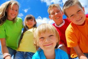 happy kids outdoors in summertime