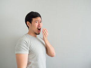 Man smelling his bad breath