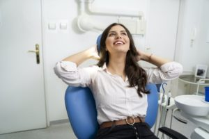 Woman smiling after visiting the cosmetic dentist